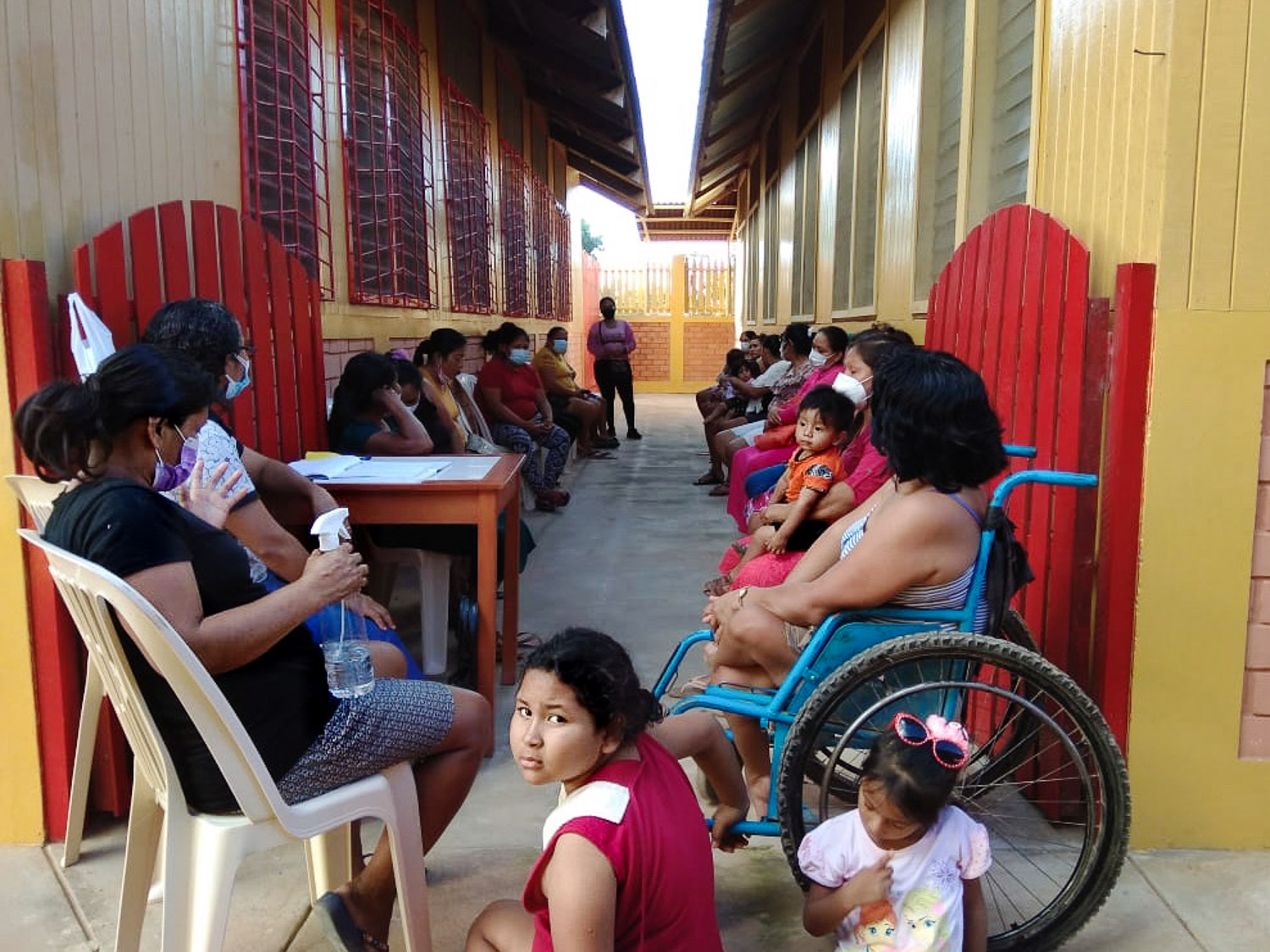 Patients wait to be seen at the medical dispensary for covid symptoms and dengue fever.
